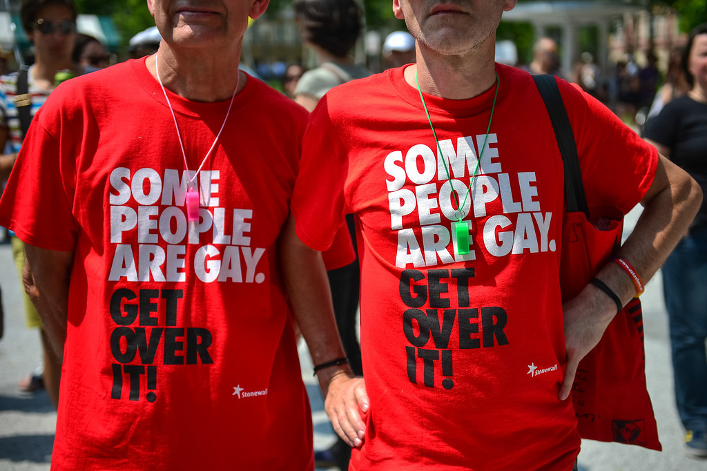 ". Two men wear tee shirts reading ""Some people are gay. Get over it!\"" during the Gay Pride Parade in Ljubljana, Slovenia, on June 15, 2013. AFP PHOTO / JURE  Makovec/AFP/Getty Images"