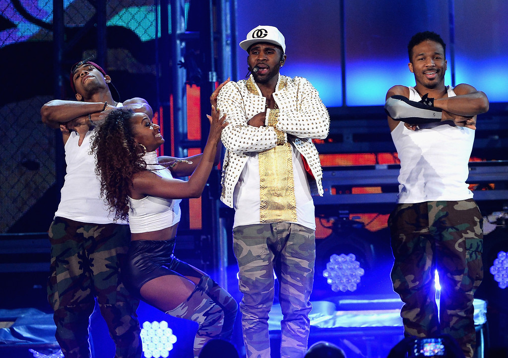. Singer Jason Derulo (2nd from right) performs onstage during the 2014 Billboard Music Awards at the MGM Grand Garden Arena on May 18, 2014 in Las Vegas, Nevada.  (Photo by Ethan Miller/Getty Images)