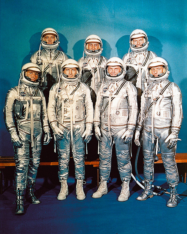 ". US Mercury program astronauts in their space suits pose for a family picture in 1962. 1rst row from left to right : Walter M. ""Wally\"" Schirra, Donald K. \""Deke\"" Slayton, John Glenn, Scott Carpenter ; 2nd row from left to right : Alan Shepard, Virgil Grissom, Gordon Cooper. AFP PHOTO NASA (Photo credit should read /AFP/Getty Images)"