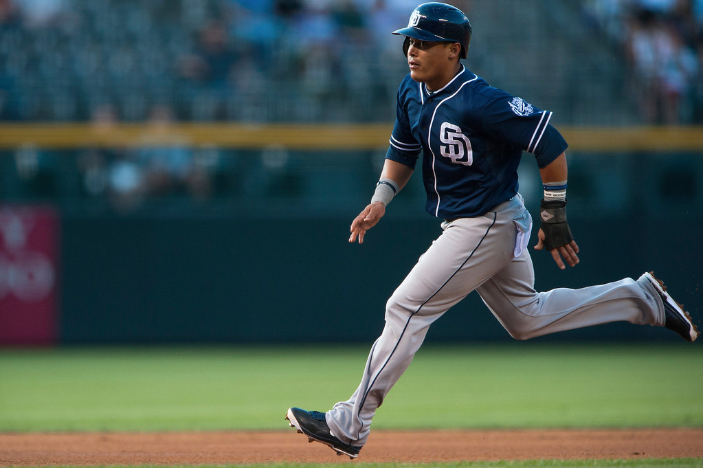 . Everth Cabrera #2 of the San Diego Padres advances from second base to third base on a fielder\'s choice in the first inning of a game against the Colorado Rockies at Coors Field on June 6, 2013 in Denver, Colorado. (Photo by Dustin Bradford/Getty Images)