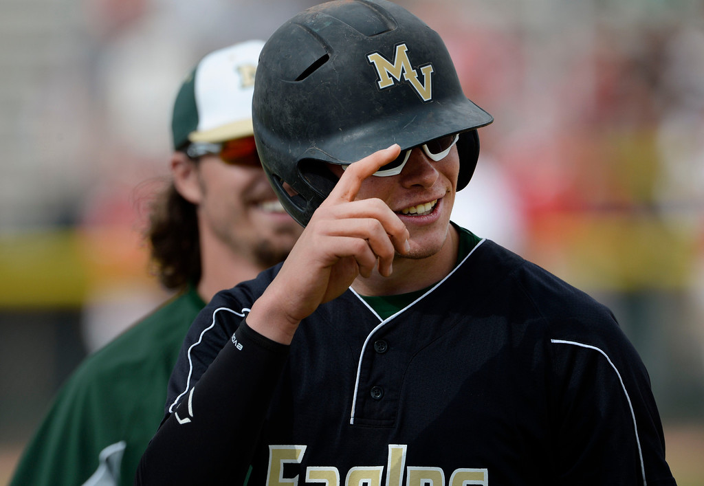 . DENVER, CO. - MAY 23:  Mountain Vista catcher, Brady Subart, acknowledges Regis outfielder, Quin Cotton, after Cotton made an outstretched catch to get him out in the 7th inning during the Colorado State 5A baseball playoffs at All City Field Friday afternoon, May 23, 2014. Subart, tipped his batting helmet to acknowledge the catch as he walked off the field. Regis went on to win 5-1. (Photo By Andy Cross / The Denver Post)