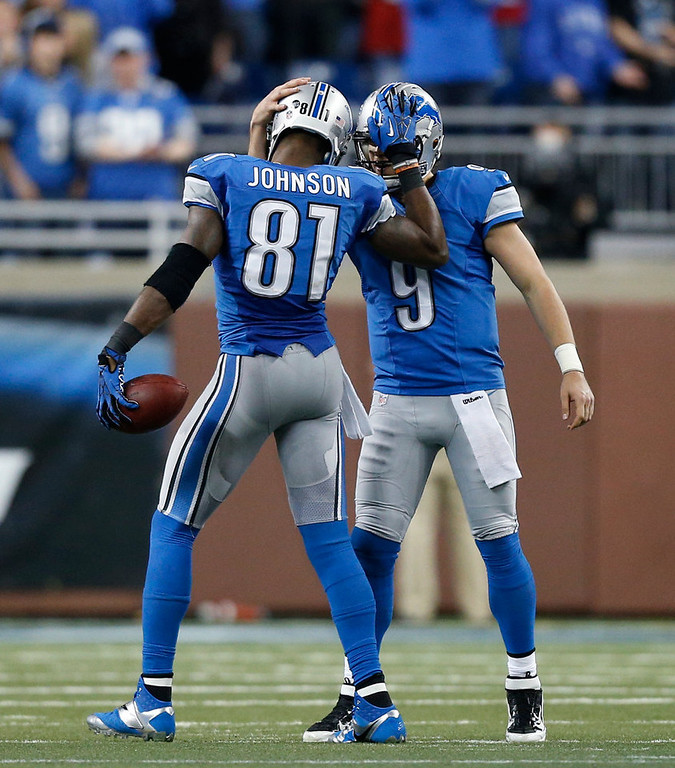 . Detroit Lions wide receiver Calvin Johnson (81) is congratulated by quarterback Matthew Stafford in the fourth quarter of an NFL football game against the Atlanta Falcons after breaking Jerry Rice\'s record for single-season receiving yards, in Detroit on Saturday, Dec. 22, 2012. (AP Photo/Rick Osentoski)