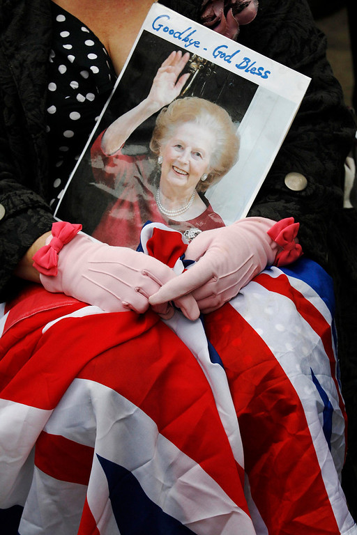 . A spectator waits for the funeral procession of former British prime minister, Margaret Thatcher, near St Paul\'s Cathedral, in London April 17, 2013. Thatcher, who was Conservative prime minister between 1979 and 1990, died on April 8 at the age of 87.   REUTERS/Luke MacGregor