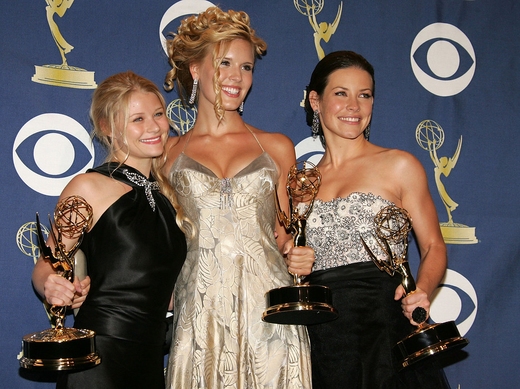 . (L-R) \'Lost\' actresses Emilie de Ravin, Maggie Grace and Evangeline Lilly pose with the Emmy for Outstanding Drama Series in the press room at the 57th Annual Emmy Awards held at the Shrine Auditorium on September 18, 2005 in Los Angeles, California. (Photo by Frazer Harrison/Getty Images)