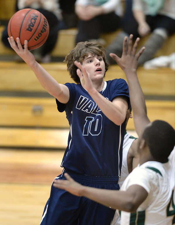 . Valor\'s Paden Mueller (10) put up a shot in the first quarter. The Valor Christian High School boy\'s basketball team defeated Aurora Central 60-52 Wednesday night, January 8, 2014. Photo By Karl Gehring/The Denver Post