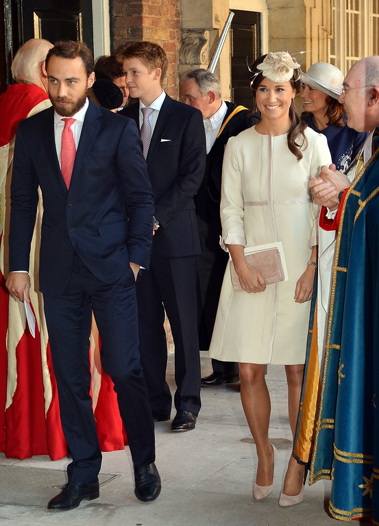 . Pippa and James Middleton (L) leave the Chapel Royal in St James\'s Palace in central London after attending the Christening of Prince George of Cambridge on October 23, 2013. Pippa Middleton, who had been wrongly tipped as a potential godparent, read a passage from the Bible at the low-key christening of Prince George, far removed from the global hype surrounding his birth. AFP PHOTO/POOL/JOHN  STILLWELL/AFP/Getty Images