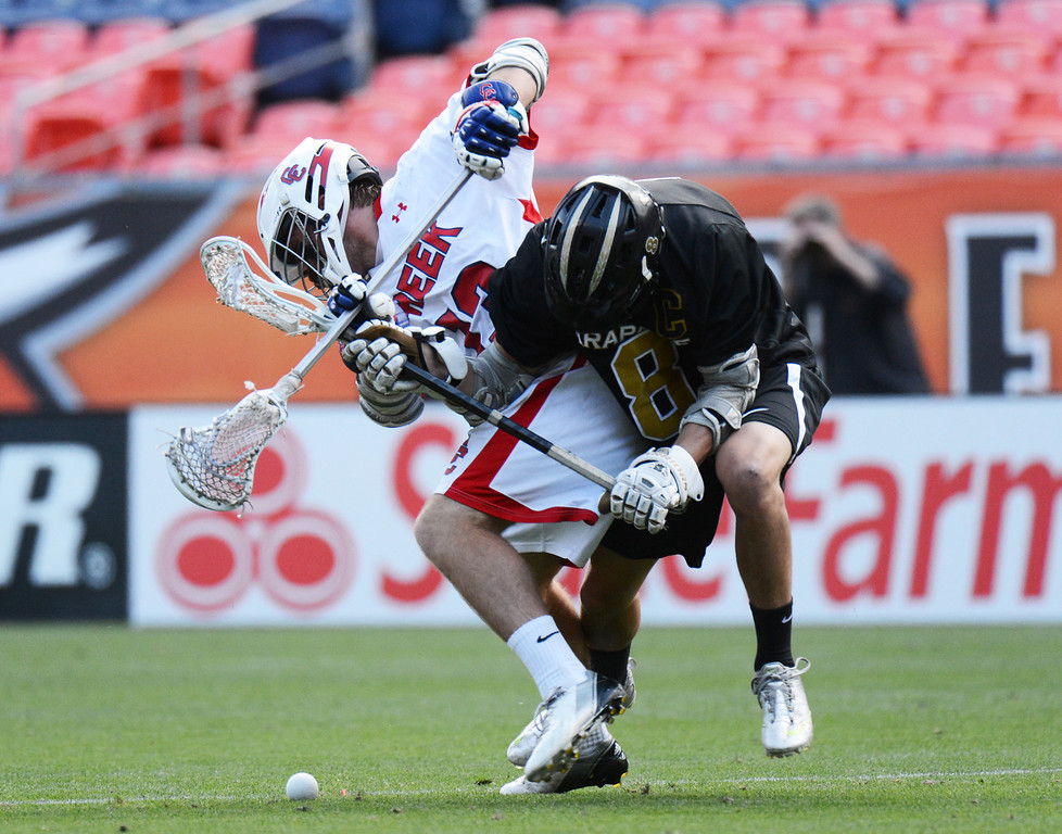 . DENVER, CO. - MAY 18 : Ben Eigner of Arapahoe High School (8) and John Eansor of Cherry Creek High School (13) are fighting for the control of ball during 5A Boy\'s Lacrosse Championship game at Sports Authority Field at Mile High Stadium. Denver, Colorado. May 18, 2013. Arapahoe won 10-7. (Photo By Hyoung Chang/The Denver Post)