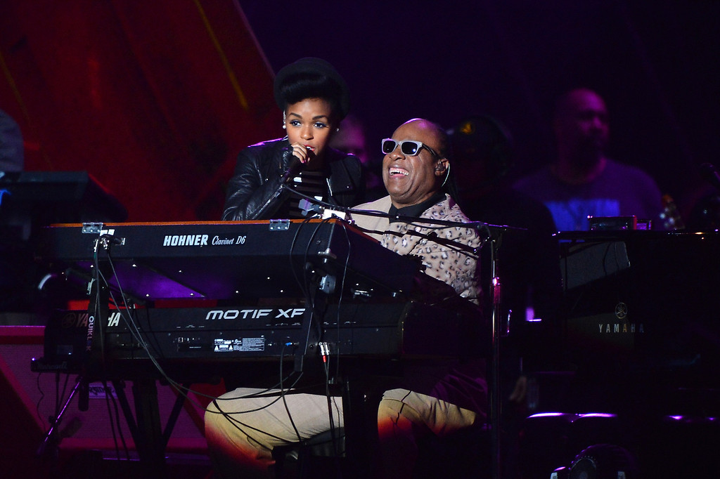 . NEW YORK, NY - SEPTEMBER 28:  Singer-songwriter Janelle Monae and Stevie Wonder perform at the 2013 Global Citizen Festival in Central Park to end extreme poverty on September 28, 2013 in New York City, New York.  (Photo by Stephen Lovekin/Getty Images for Global Citizen Festival)