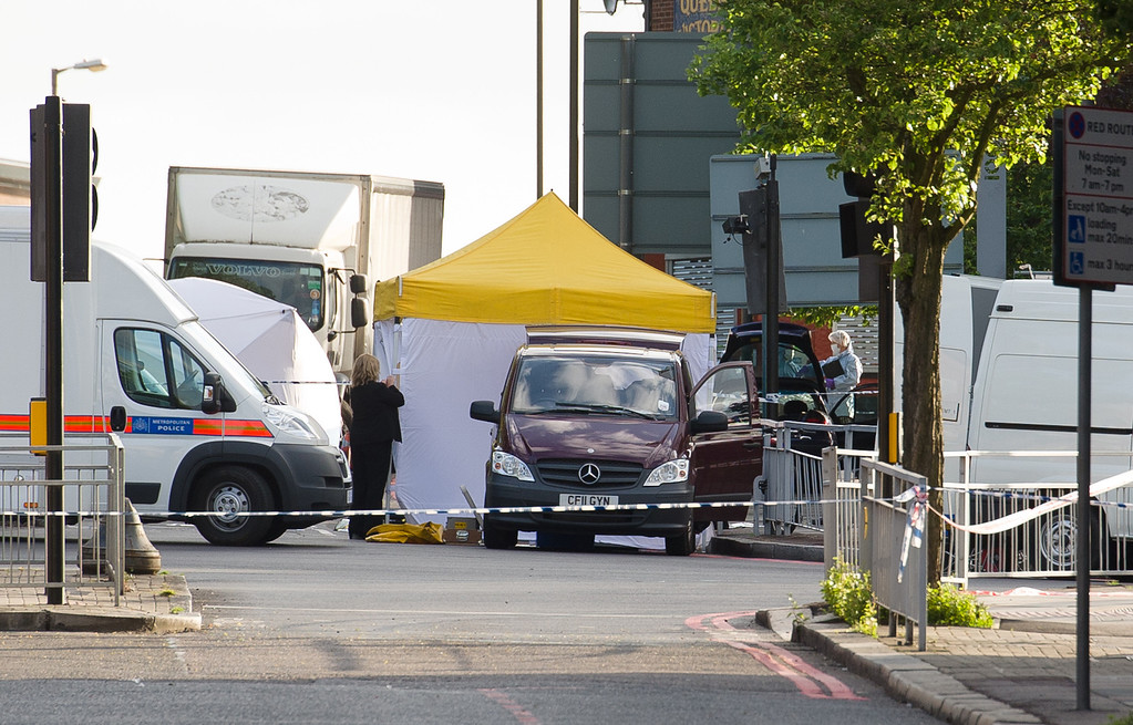 . Police forensics tents and officers are seen in Woolwich, east London, on May 22, 2013.   AFP PHOTO/Leon  NEAL/AFP/Getty Images