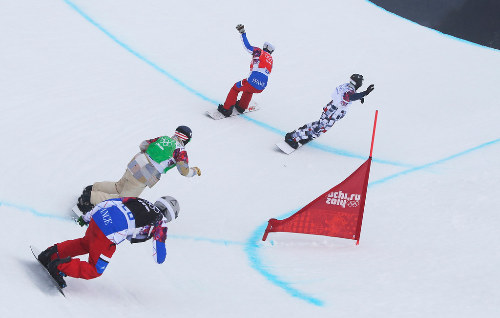 . Gold medalist Pierre Vaultier of France, top center, and silver medalist Nikolai Olyunin of Russia, right, lead Paul�-Henri de le Rue of France, left, and bronze medalist Alex Deibold of the United States, through the last turn in the men\'s snowboard cross final at the Rosa Khutor Extreme Park, at the 2014 Winter Olympics, Tuesday, Feb. 18, 2014, in Krasnaya Polyana, Russia. (AP Photo/Sergei Grits)