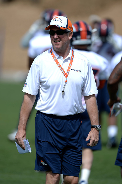 . Denver Broncos head coach John Fox walks the field during OTAs June 16, 2014 at Dove Valley. (Photo by John Leyba/The Denver Post)