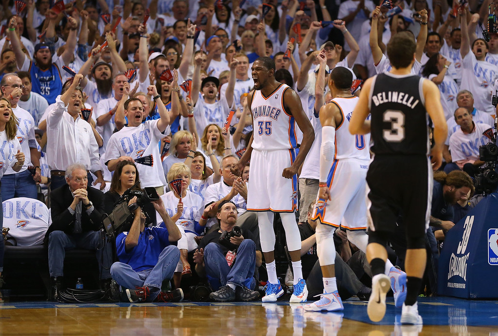 . OKLAHOMA CITY, OK - MAY 31:  Kevin Durant #35 and Russell Westbrook #0 of the Oklahoma City Thunder celebrate after a play against the San Antonio Spurs in the first half during Game Six of the Western Conference Finals of the 2014 NBA Playoffs at Chesapeake Energy Arena on May 31, 2014 in Oklahoma City, Oklahoma. (Photo by Ronald Martinez/Getty Images)
