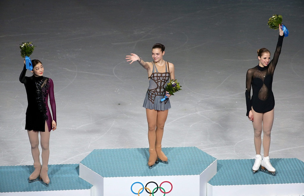 . (L-R) Silver medalist Kim Yuna of South Korea, gold medalist Adelina Sotnikova of Russia and bronze medalist Carolina Kostner of Italy during the flower ceremony after the Women\'s Free Skating Figure Skating event at Iceberg Skating Palace during the Sochi 2014 Olympic Games, Sochi, Russia, 20 February 2014.  EPA/BARBARA WALTON