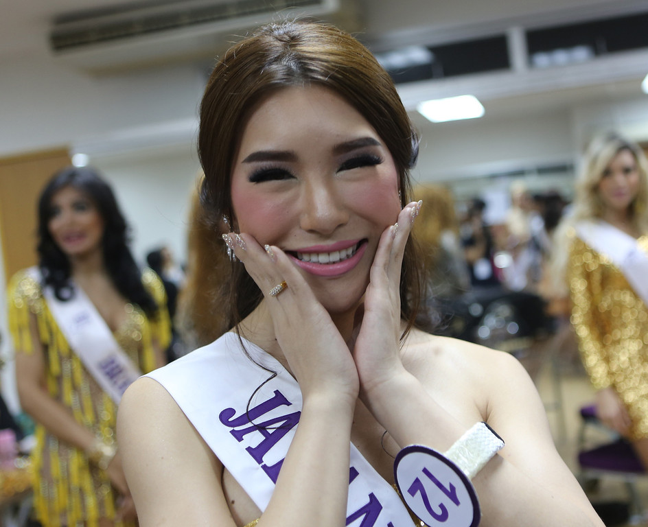 . Annabel Yu of Japan poses during a backstage photo session at the Miss International Queen 2013 transgender beauty pageant in Pattaya, southeastern Thailand Friday, Nov. 1, 2013. Twenty-five contestants from 17 countries participate in this year\'s pageant which has been held for nine respective years. (AP Photo/Apichart Weerawong)