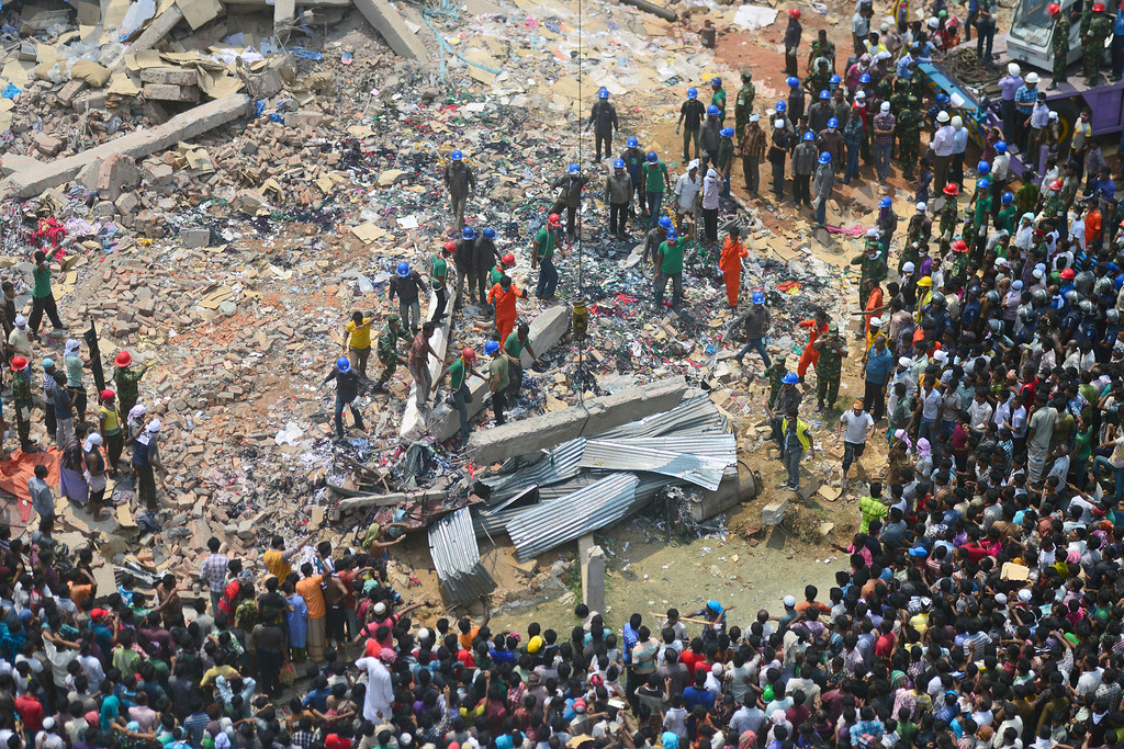 . Bangladeshi volunteers and rescue workers assist in rescue operations after an eight-storey building collapsed in Savar, on the outskirts of Dhaka, on April 25, 2013. Survivors cried out to rescuers April 25 from the rubble of a block of garment factories in Bangladesh that collapsed killing 175 people, sparking criticism of their Western clients. AFP PHOTO/Munir uz ZAMAN/AFP/Getty Images