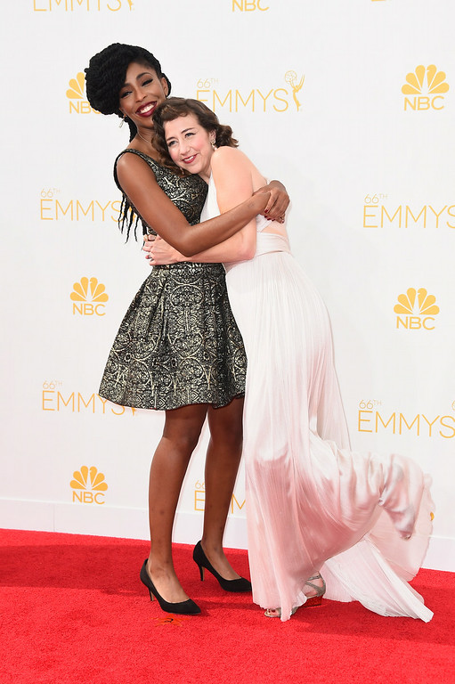 . Actresses Jessica Williams (L) and Kristen Schaal attend the 66th Annual Primetime Emmy Awards held at Nokia Theatre L.A. Live on August 25, 2014 in Los Angeles, California.  (Photo by Frazer Harrison/Getty Images)