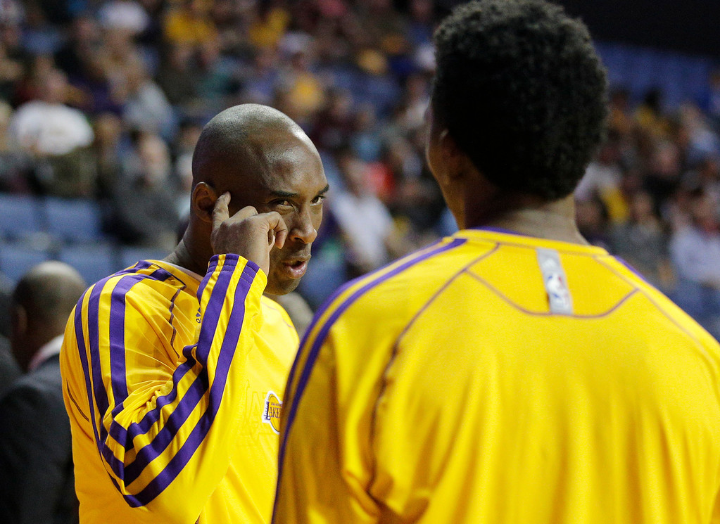 . Los Angeles Lakers\' Kobe Bryant, left, talks to Nick Young before an NBA preseason basketball game against the Denver Nuggets on Tuesday, Oct. 8, 2013, in Ontario, Calif. (AP Photo/Jae C. Hong)