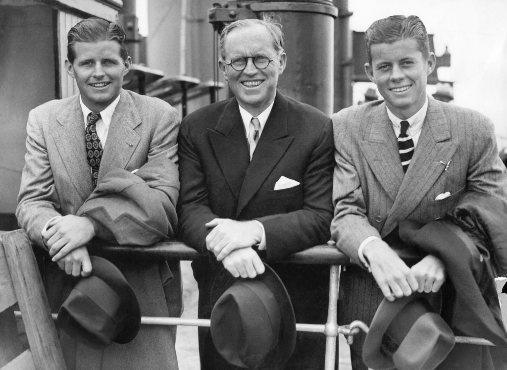 """. Kennedy with brother Joe Jr., left, and father, Joseph, on July 5, 1938, in Southampton on the deck of the French \""""Normandy\"""" cruise liner after their arrival from the U.S. AFP/Getty Images"""