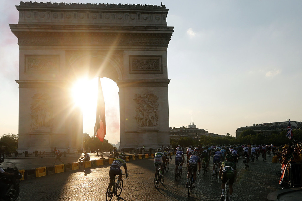 . The pack rides at Paris\' landmark Arc de Triomphe on the Champs Elysee avenue during the 133.5 km twenty-first and last stage of the 100th edition of the Tour de France cycling race on July 21, 2013 between Versailles and Paris.  JOEL SAGET/AFP/Getty Images