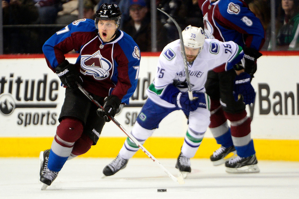 . DENVER, CO - MARCH 24: John Mitchell (7) of the Colorado Avalanche works into the open ice against the Vancouver Canucks during the third period of action. The Colorado Avalanche lost to the Vancouver Canucks 3-2 at the Pepsi Center. (Photo by AAron Ontiveroz/The Denver Post)