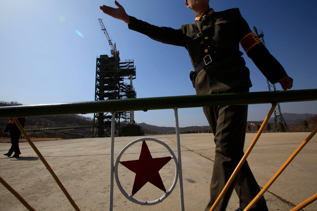 . FILE - In this April 8, 2012 file photo, a North Korean soldier stands in front of the country\'s Unha-3 rocket, slated for liftoff between April 12-16, at Sohae Satellite Station in Tongchang-ri, North Korea. North Korea fired a long-range rocket Wednesday, Wednesday, Dec. 12, 2012 in its second launch under its new leader, South Korean officials said, defying warnings from the U.N. and Washington only days before South Korean presidential elections. (AP Photo/Ng Han Guan, File)