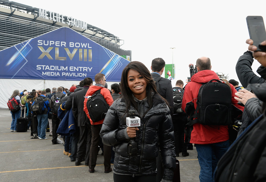 . Former Olympic gymnist and TV personality Gabby Douglas speaks at the Pepsi Super Bowl XLVIII Pregame Show at MetLife Stadium on February 2, 2014 in East Rutherford, New Jersey.  (Photo by Larry Busacca/Getty Images)