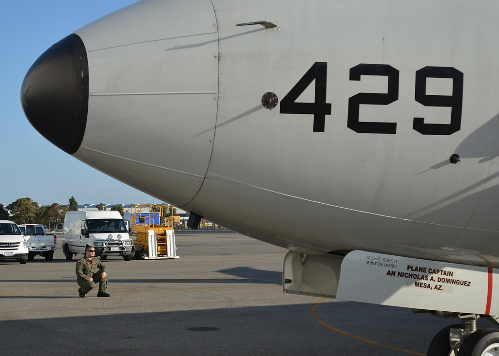 . This handout photo taken on March 20, 2014 and released on March 21, 2014 by the US Navy showsNaval Aircrewman Operator 2nd Class Mike Burnett (L), an electronic warfare operator attached to Patrol Squadron (VP) 16, watching the exterior of a P-8A Poseidon during a high-frequency radio check before a mission to assist in search and rescue operations for Malaysia Airlines flight MH370 March 20. VP-16 is currently deployed in the US 7th Fleet area of responsibility supporting security and stability in the Indo-Asia-Pacific region.Australia on March 21 said radars had failed to detect any sign of a missing Malaysian jetliner and it was switching to skilled observers to spot any debris in the remote southern Indian Ocean. AFP PHOTO / US Navy photo by Mass Communication Specialist 2nd Class Eric A. Pastor/Released /AFP/Getty Images