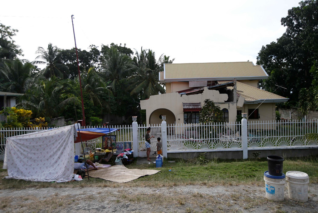 . Residents camp out at an open field to avoid aftershocks at Loon township, Bohol province in central Philippines Wednesday Oct. 16, 2013. (AP Photo/Bullit Marquez)