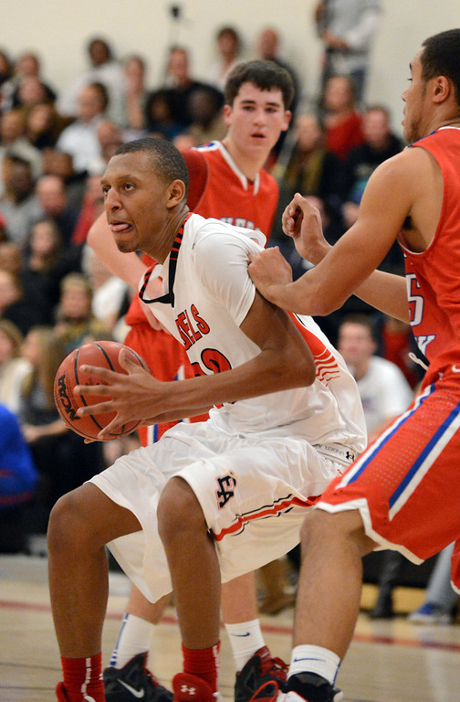 . East\'s Tyre Robinson, left, controls the offensive rebound in the 1st half of the game against Cherry Creek\'s at East High School on Friday, Nov. 30, 2012. Hyoung Chang, The Denver Post