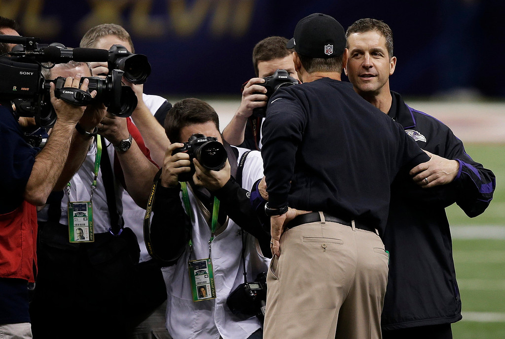 . San Francisco 49ers head coach Jim Harbaugh, left, embraces his brother Baltimore Ravens head coach John Harbaugh before the NFL Super Bowl XLVII football game, Sunday, Feb. 3, 2013, in New Orleans. (AP Photo/Bill Haber)