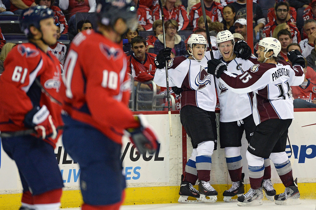 . WASHINGTON, DC - OCTOBER 12: Nathan MacKinnon #29 of the Colorado Avalanche (left) celebrates after scoring a goal with teammates Gabriel Landeskog #92 (center) and PA Parenteau #15 against the Washington Capitals in the second period at Verizon Center on October 12, 2013 in Washington, DC. (Photo by Patrick Smith/Getty Images)