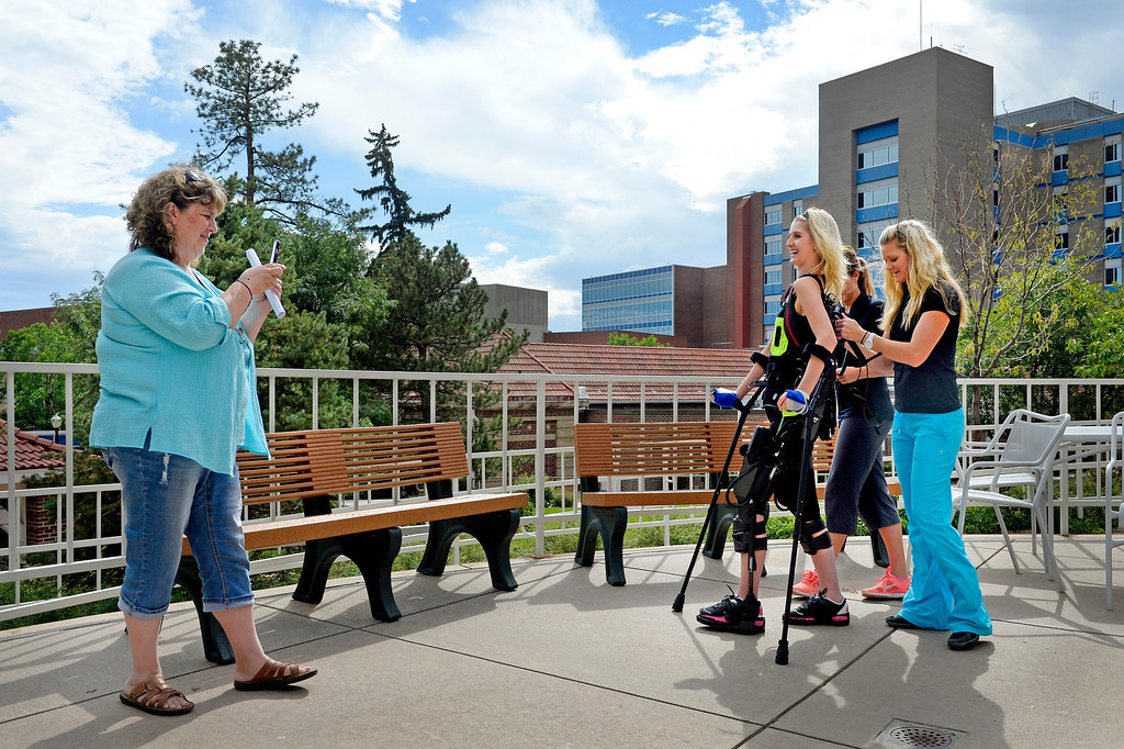 . Mackenzie was exhilarated to walk upright, outdoors, near the end of her summer therapy at Craig. The exoskeleton senses patients� intentions and can complete their step. Karen Gorden hopes such devices will become cheaper and more common: �I just wish it was something she could have and use, she would be so independent.� (Photo By Craig F. Walker / The Denver Post)
