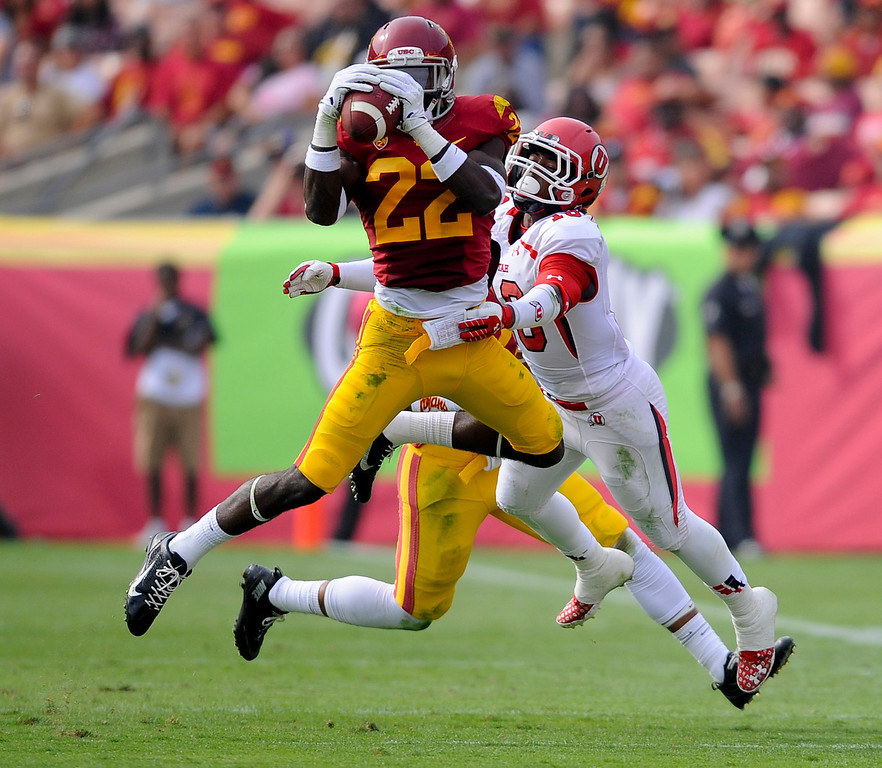 . Southern California safety Leon McQuay III (22) intercepts a pass to Utah wide receiver Geoff Norwood (16) during the first half of an NCAA college football game, Saturday, Oct. 26, 2013, in Los Angeles. (AP Photo/Gus Ruelas)