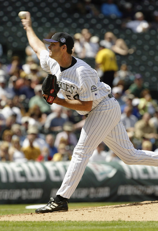 . DENVER - APRIL 15:  Starting pitcher Scott Elarton #50 of the Colorado Rockies delivers a pitch against the Arizona Diamondbacks in the second inning at Coors Field on April 15, 2004 in Denver, Colorado.  Elarton took the loss, giving up nine runs on seven hits in four and two-thirds innings during the Diamondbacks 11-10 win.  (Photo by Brian Bahr/Getty Images)