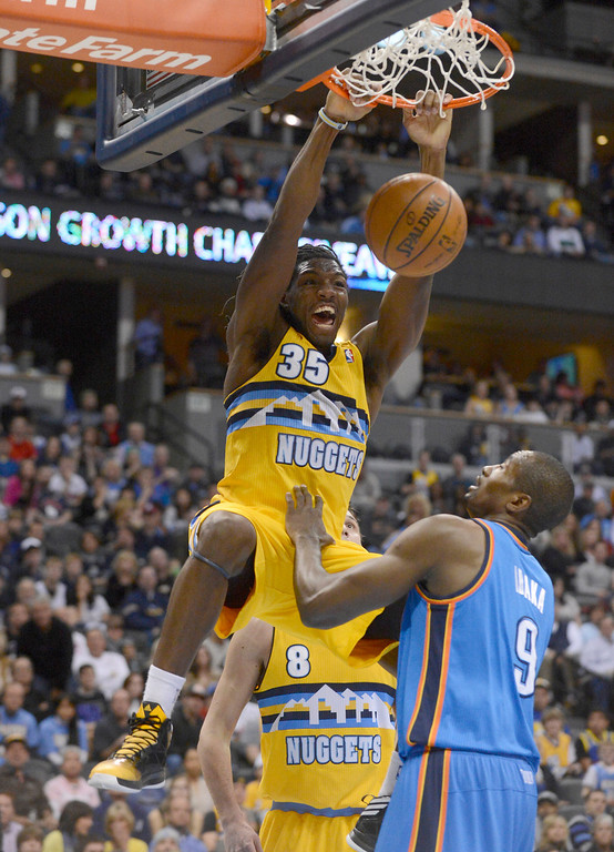 . DENVER, CO. - JANUARY 20: Denver Nuggets small forward Kenneth Faried (35) screams out after slamming down a dunk on Oklahoma City Thunder power forward Serge Ibaka (9) during the first quarter January 20,  2013 at Pepsi Center. The Denver Nuggets defeated the Oklahoma City Thunder 121-118.  (Photo By John Leyba / The Denver Post)
