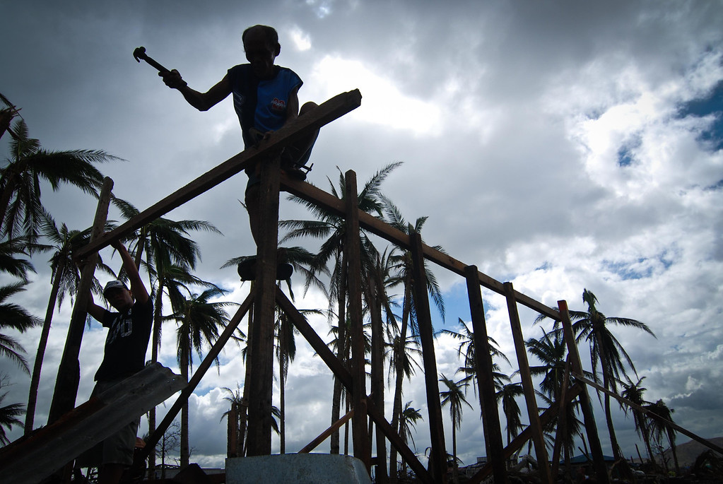 . A man tries to rebuild his shanty near the shoreline following the recent super typhoon on November 21, 2013 in Tacloban, Leyte, Philippines. Typhoon Haiyan, which ripped through the Philippines on November 9, has been described as one of the most powerful typhoons ever to hit land, leaving thousands dead and hundreds of thousands homeless. Countries all over the world have pledged relief aid to help support those affected by the typhoon, however damage to the airport and roads have made moving the aid into the most affected areas very difficult. With dead bodies left out in the open air and very limited food, water and shelter, health concerns are growing.  (Photo by Dondi Tawatao/Getty Images)