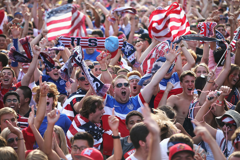 . Fans in Grant Park celebrate a goal by the U.S. against Portugal in a Group G World Cup soccer match on June 22, 2014 in Chicago, Illinois. Fans were turned away from the free event after a 10,000-person capacity was reached.  (Photo by Scott Olson/Getty Images)