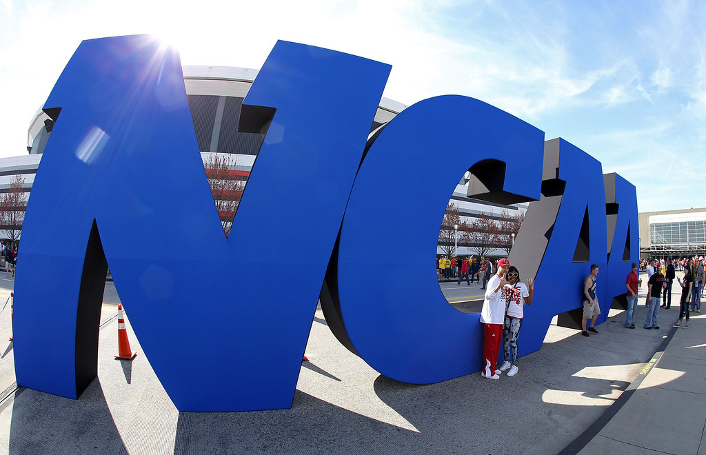 . ATLANTA, GA - APRIL 06:  A NCAA logo is seen outside the Georgia Dome before the 2013 NCAA Men\'s Final Four Semifinal between the Louisville Cardinals and the Wichita State Shockers on April 6, 2013 in Atlanta, Georgia.  (Photo by Streeter Lecka/Getty Images)