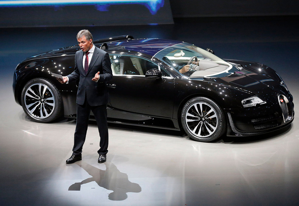 . Bugatti CEO Wolfgang Schreiber introduces the new Veyron during a preview by the Volkswagen Group prior to the 65th Frankfurt Auto Show in Frankfurt, Germany, Monday, Sept. 9, 2013. More than 1,000 exhibitors will show their products to the public from Sept. 12 through Sept. 22, 2013. (AP Photo/Frank Augstein)