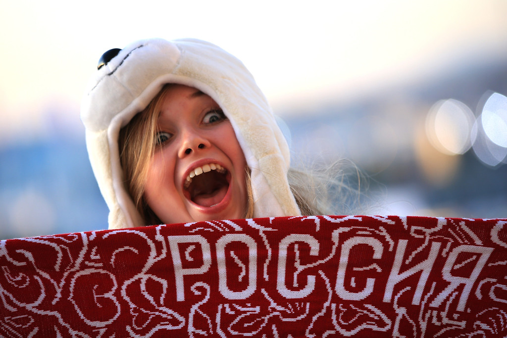 . A spectator poses as she arrives for the Opening Ceremony of the Sochi 2014 Winter Olympics at Fisht Olympic Stadium on February 7, 2014 in Sochi, Russia.  (Photo by Richard Heathcote/Getty Images)
