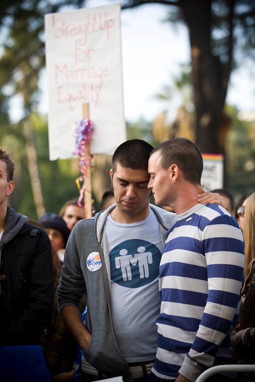 . SACRAMENTO, CA - NOVEMBER 22:  Thomas Losa (L) and Travis Coble listen to speakers at a rally in support of gay marriage on the steps of the State Capitol November 22, 2008 in Sacramento, California. People across the country continue to protest the passing of California State Proposition 8 which makes gay marriage in California illegal. (Photo by Max Whittaker/Getty Images)