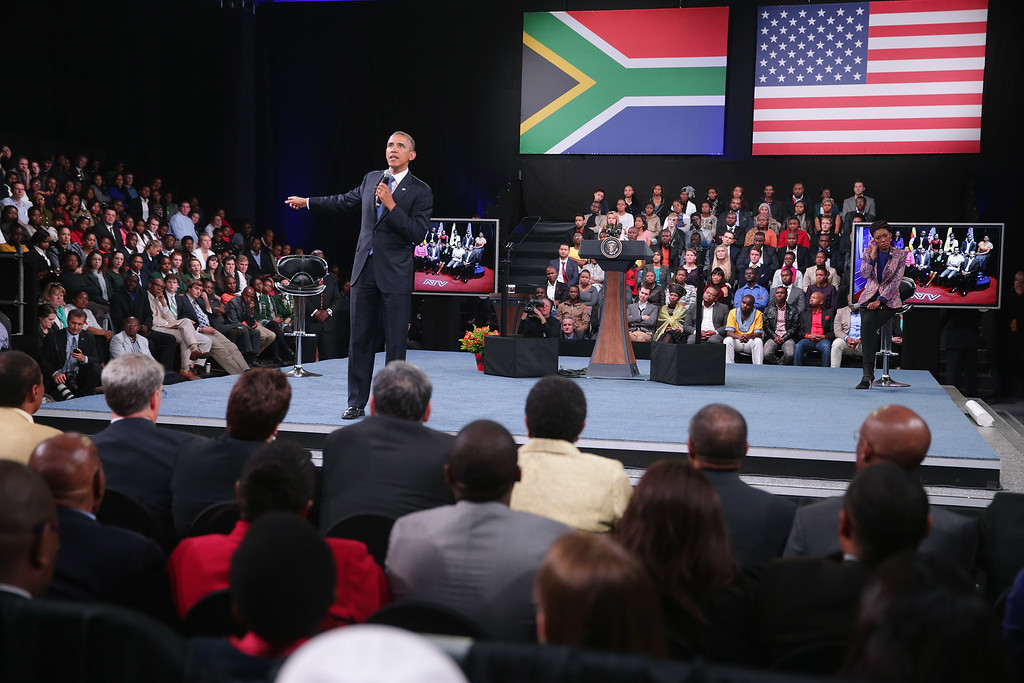 ". JOHANNESBURG, SOUTH AFRICA - JUNE 29:  U.S. President Barack Obama answers questions from the audience and from people in Nigeria, Uganda and Kenya via live video link during a ""town hall\"" meeting with the young African leaders at the University of Johannesburg in Soweto June 29, 2013 in Johannesburg, South Africa. South Africa is the second leg of Obama\'s three-country tour of the African continent, which includes Senegal and Tanzania.  (Photo by Chip Somodevilla/Getty Images)"