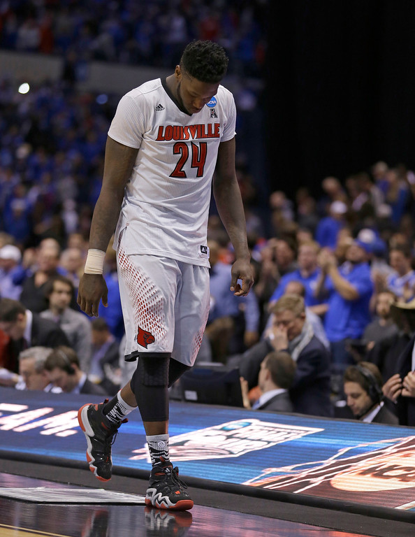 . Louisville\'s Montrezl Harrell walks off the court after an NCAA Midwest Regional semifinal college basketball tournament game against the Kentucky Saturday, March 29, 2014, in Indianapolis. Kentucky won 74-69. (AP Photo/Michael Conroy)