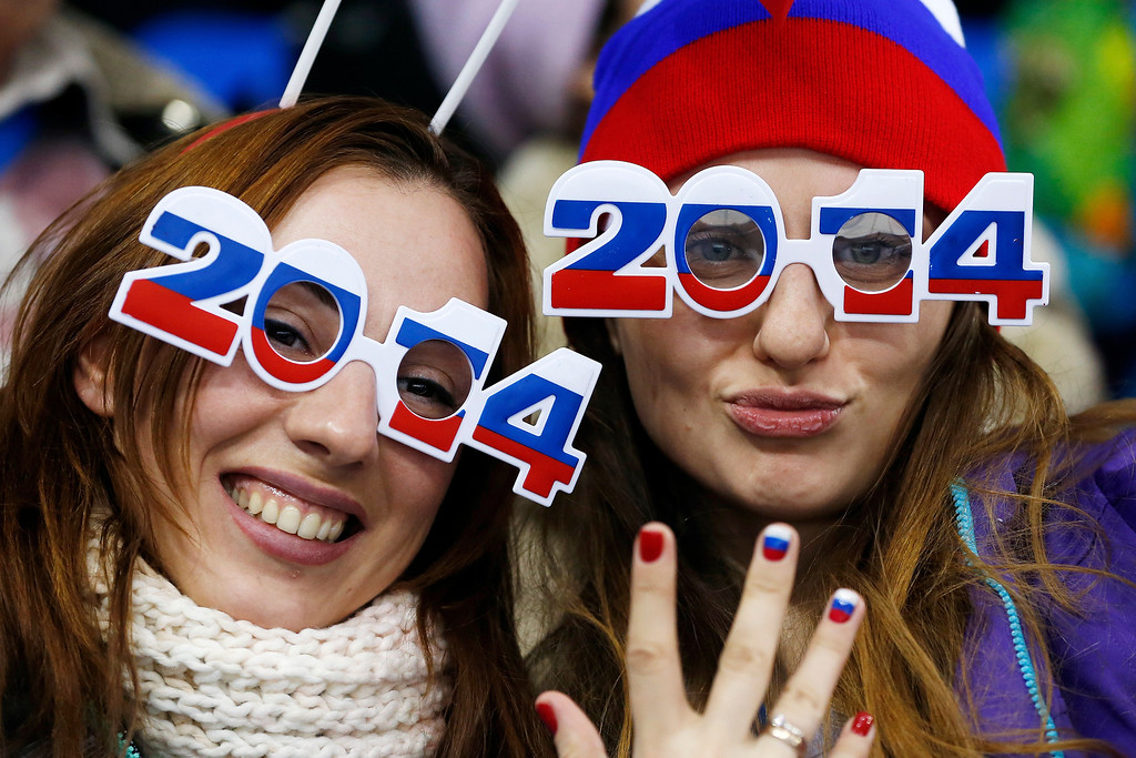 . Russian fans sport 2014 glasses as they cheer during the 2014 Winter Olympics women\'s ice hockey game between Russia and Germany at Shayba Arena, Sunday, Feb. 9, 2014, in Sochi, Russia. (AP Photo/Petr David Josek)