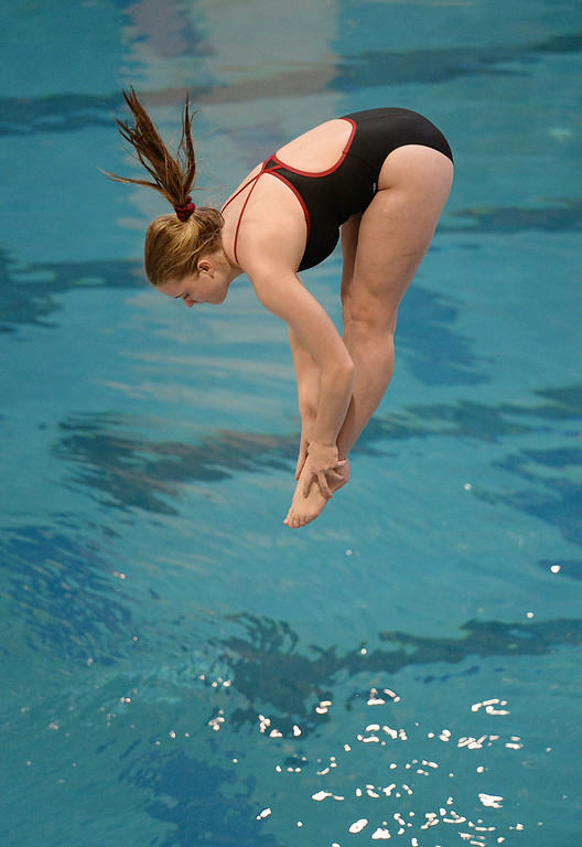 . THORNTON, CO. - FEBRUARY 15, 2014: Regis Jesuit junior Kellyn Toole twisted through the air on her third dive Saturday. The CHSAA 5A Girl\'s State Swimming Championships wrapped up Saturday night February 14, 2104.  Photo By Karl Gehring/The Denver Post