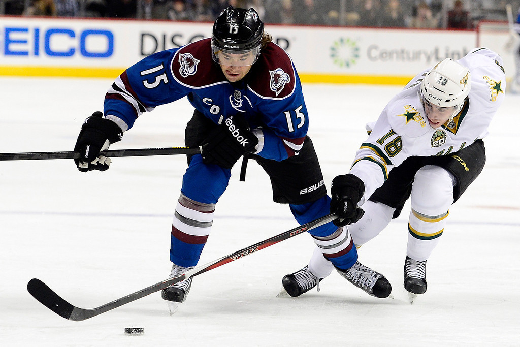 . DENVER, CO. - FEBRUARY 4: P.A. Parenteau (15) of the Colorado Avalanche and Reilly Smith (18) of the Dallas Stars compete for the puck during the third period of Dallas\'s 3-2 win. Colorado Avalanche versus the Dallas Stars at the Pepsi Center on February 4, 2012. (Photo By AAron Ontiveroz/The Denver Post)