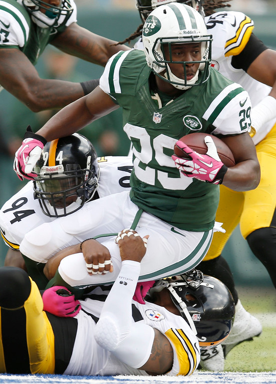 . New York Jets running back Bilal Powell (29) is tackled by Pittsburgh Steelers free safety Ryan Clark, below, and Lawrence Timmons (94) during the first half of an NFL football game Sunday, Oct. 13, 2013, in East Rutherford, N.J.  (AP Photo/Kathy Willens)