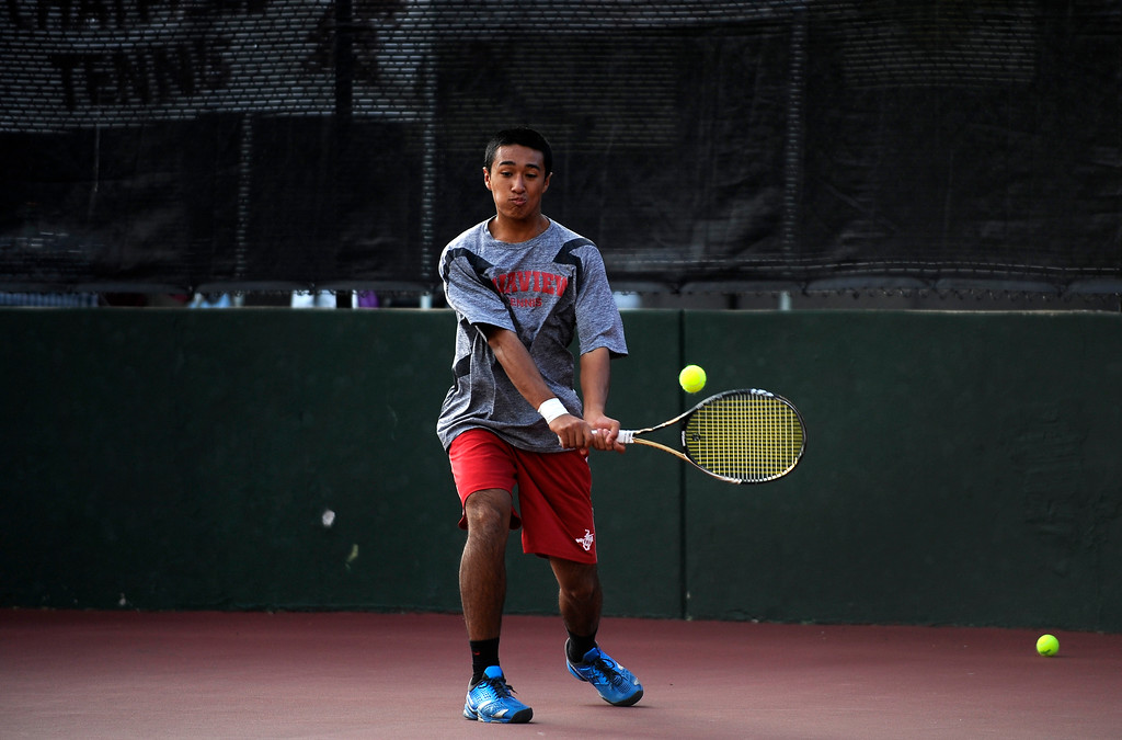 . DENVER, CO. - OCT 12:   Ignatius Castelino of Fairview returns to Cherry Creek opponent Zach Fryer. The boys were playing in the #1 singles final during the final day of the 5A Boys\' Tennis Championships at Gates Tennis Center on Oct. 12, 2013.  (Photo By Erin Hull/The Denver Post)