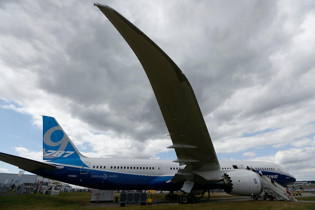 . Visitors walk on board a Boeing 787 on display during Farnborough International Air Show, Farnborough, England, Tuesday, July 15, 2014. (AP Photo/Sang Tan)