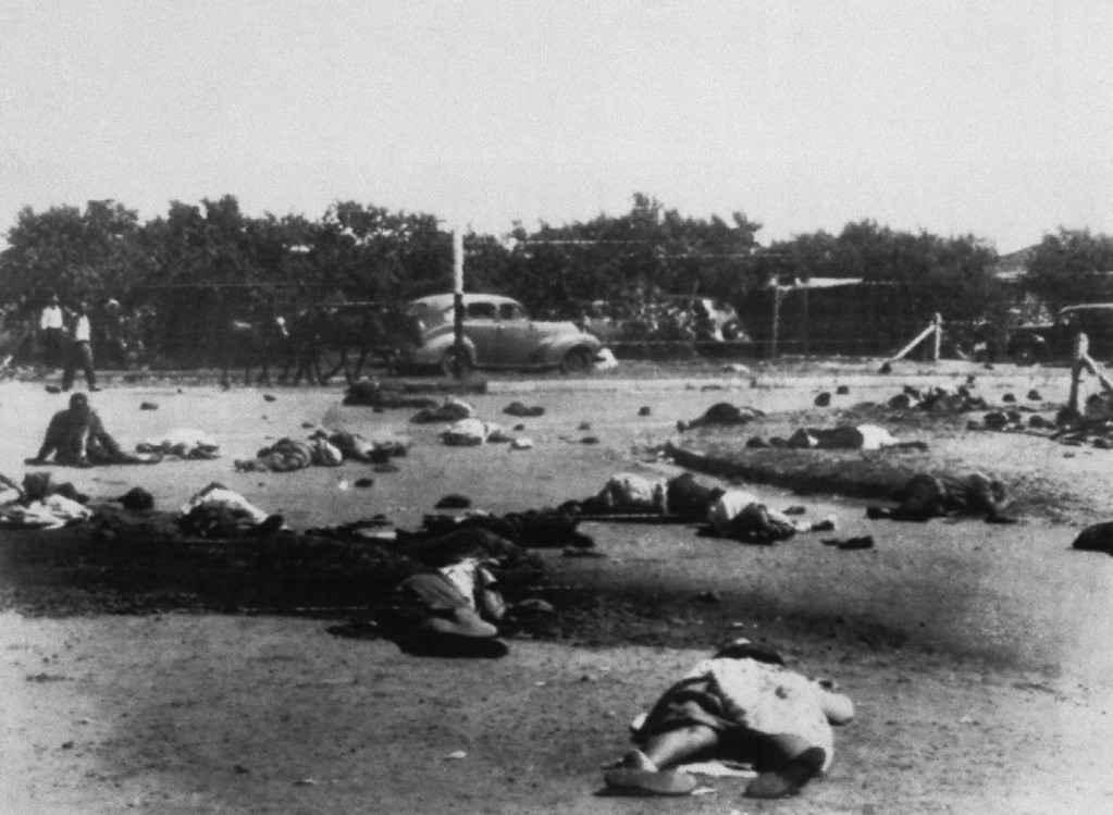 . Bodies of dead and some wounded persons are left following the South African police\'s massacre of people in Sharpeville, South Africa, March 22, 1960.  (AP Photo)